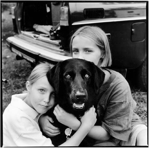 two girls and their dog